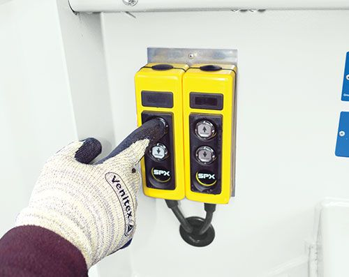Push button controls to lower front and rear hydraulic rams