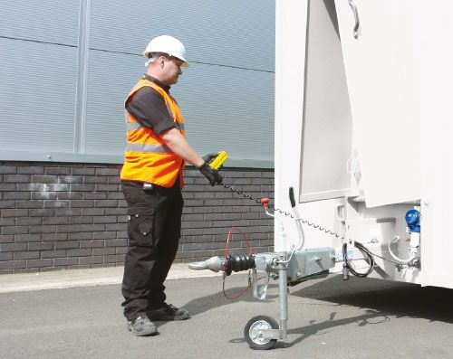 Unhitch from towing vehicle and operate hydraulics using the push button controls